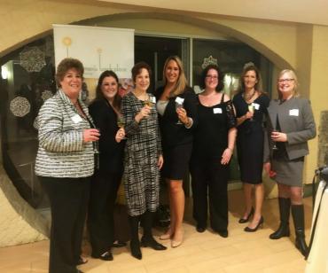 REBA Board Members raising their glass to a wonderful cause!